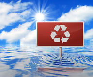 Recycling Road Sign in Flooded Area. Recycling Symbol on a Road Sign in Flooded Area Royalty Free Stock Images