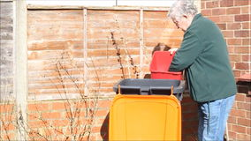 Recycling rubbish in a a trash can or rubbish bin. stock video