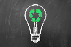 Recycling or saving electric energy Stock Photos