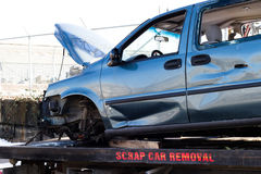 Recycling scrap car removal service for future dismantling and metal and parts reuse. Royalty Free Stock Image