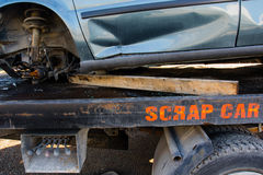 Recycling scrap car removal service for future dismantling and metal and parts reuse. Stock Image