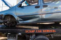 Recycling scrap car removal service for future dismantling and metal and parts reuse. Stock Photography