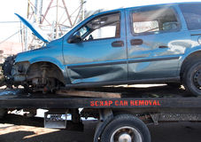 Recycling scrap car removal service for future dismantling and metal and parts reuse. Stock Images