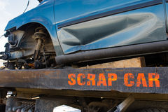 Recycling scrap car removal service for future dismantling and metal and parts reuse. Royalty Free Stock Photography