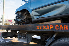 Recycling scrap car removal service for future dismantling and metal and parts reuse. Stock Photo