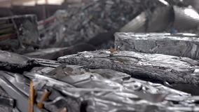 Recycling scrap metal. In the frame briquettes pressed from aluminum waste. Ready raw materials for remelting stock video