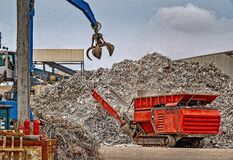 Recycling scrap metal at a waste management facility royalty free stock photos