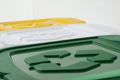 Recycling series. Recycling symbols on recycling bins, high angle view Stock Image
