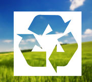 Recycling sign against landscape background Stock Photos