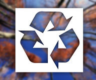 Recycling sign with nature background Royalty Free Stock Photo