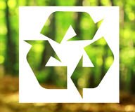 Recycling sign with nature background Royalty Free Stock Image