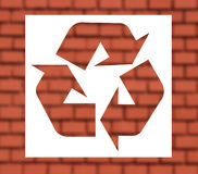 Recycling sign with red brickwall Royalty Free Stock Photo