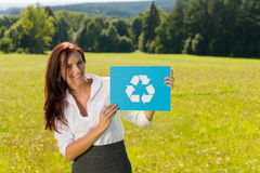 Recycling sign - Young businesswoman sunny meadow Royalty Free Stock Image