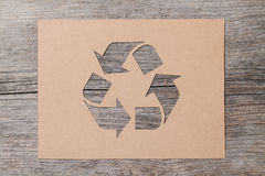 Recycling. Stencil paper of recycling on wood background Stock Images
