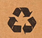 Recycling symbol. On scratched brown board Stock Image