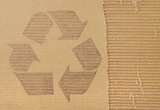 Recycling symbol. Drawn on cardboard Royalty Free Stock Images