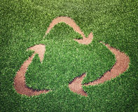 Recycling symbol. In a field of grass Stock Photo