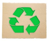 Recycling symbol. On a cardboard  texture Stock Photography