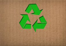 Recycling-Symbol auf Pappbeschaffenheit Lizenzfreies Stockfoto