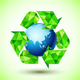 Recycling Symbol with Blue Globe Royalty Free Stock Photos