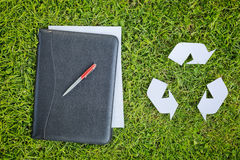 Recycling Symbol and Business Documents Stock Image