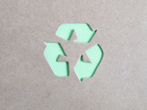 Recycling symbol on cardboard Royalty Free Stock Image