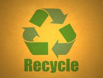Recycling symbol on cardboard Stock Images