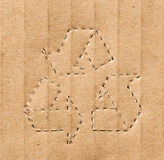 Recycling symbol on the carton Stock Photos