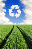 Recycling symbol from clouds Royalty Free Stock Photo