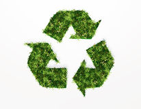Recycling symbol covered by grass and flowers. A top view of a recycling symbol covered by grass and flowers, on a white background Stock Photography