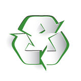 Recycling Symbol Cut Paper Design. Recycling symbol icon on white ground, cut paper appearance with green showing through Royalty Free Stock Images