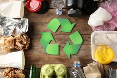 Recycling symbol and different garbage stock images