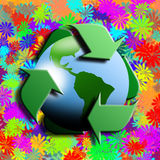 Recycling symbol with earth in the centre. And flowers in the background Stock Images