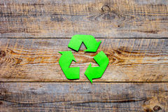 Recycling symbol in eco concept on wooden background top view mockup Royalty Free Stock Photo