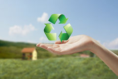 Recycling symbol on a female hand. Royalty Free Stock Images