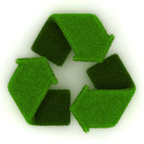 Recycling Symbol in Grass. On white background Stock Images