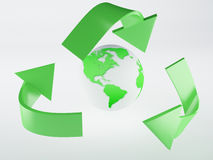 Recycling symbol and green earth Royalty Free Stock Photo