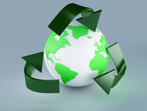 Recycling symbol and green earth Royalty Free Stock Images