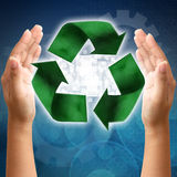 Recycling symbol on hand Stock Photography