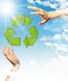 Recycling symbol and hands Royalty Free Stock Photography