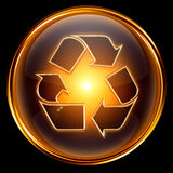 Recycling symbol icon gold Stock Photos