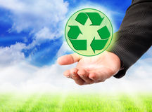 Recycling symbol on a man's hand. Stock Photo