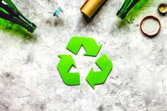Recycling symbol with waste on gray background top view mock up stock photo