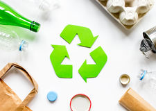 Recycling symbol with waste on white background top view Stock Photo