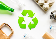 Recycling symbol with waste on white background top view Stock Images