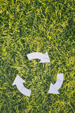 Recycling Symbol. White recycling sign over green grass, top view with copy space Royalty Free Stock Photography