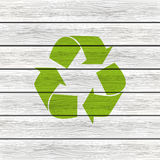Recycling symbol on wood Royalty Free Stock Photo