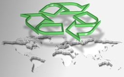 Recycling symbol and world. Green recycling symbol suspended in the air above world map Royalty Free Stock Photography