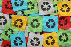 Recycling symbols. Pile of crumpled colorful paper notes with Recycling symbols Royalty Free Stock Photos