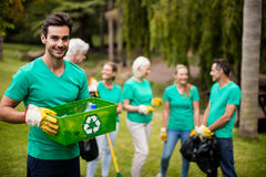 Recycling team member standing in park. Portrait of recycling team member standing in park Royalty Free Stock Images